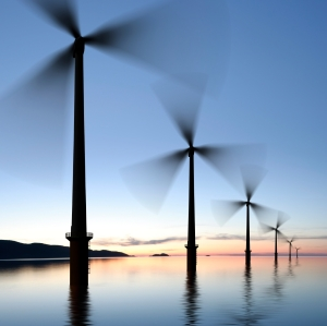 offshore wind turbines in silhouette at twilight, square frame