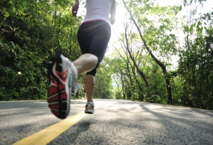 healthy lifestyle fitness sports woman legs  running at mountain road