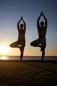 Man-and-Woman-in-Yoga-Pose-000004472015_Large